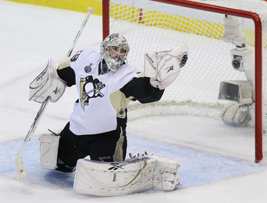 Penguins goalie Marc-Andre Fleury makes a stop against Detroit in the second period. Photo: Carlos Osorio, AP