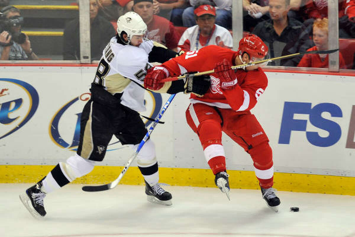 Pittsburgh's Kris Letang draws contact against Detroit's Valtteri Filppula.