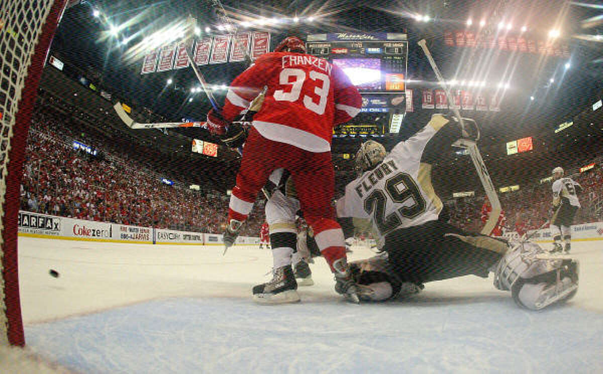 Penguins goalie Marc-Andre Fleury defends against Detroit's Johan Franzen.