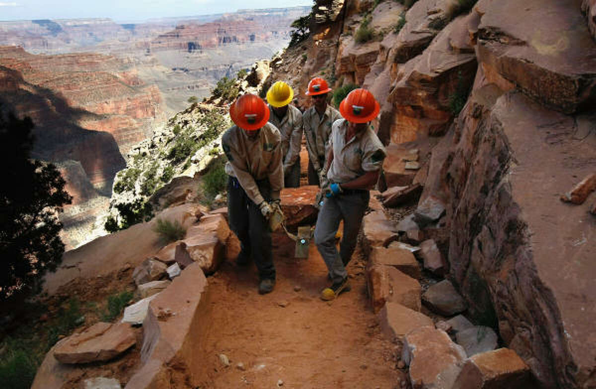 What's really going on here?: Workers repair a trail in the Grand Canyon on June 10 in a project funded with federal stimulus dollars.