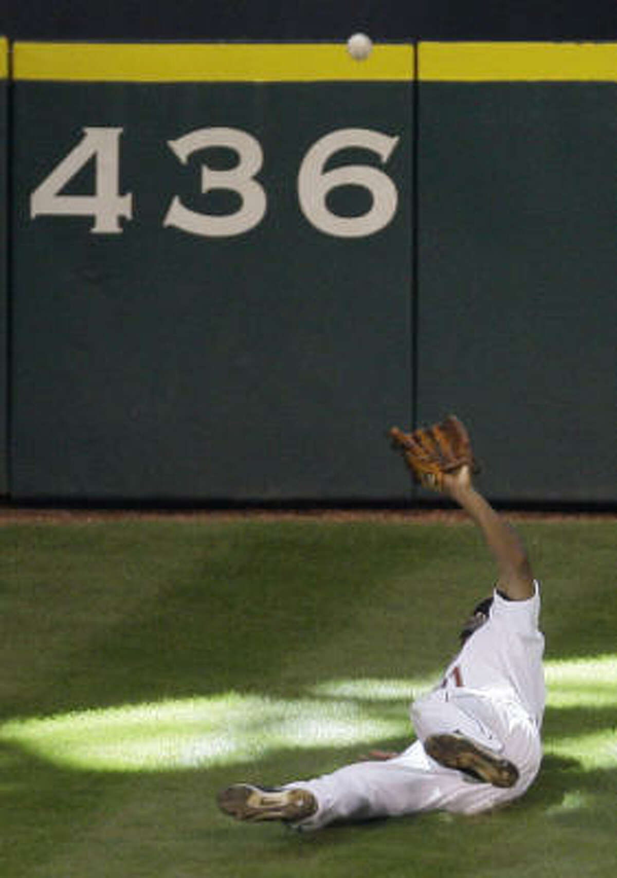 Michael Bourn - On Golden Hill Michael Bourn won Gold Gloves for his center field play in Houston in 2009 and 2010, and his deftness of Tal's Hill had something to do with those awards. His most memorable catch was this one against the Cubs'Micah Hoffpauir when Bourn fell down and still caught the ball while flat on his back.