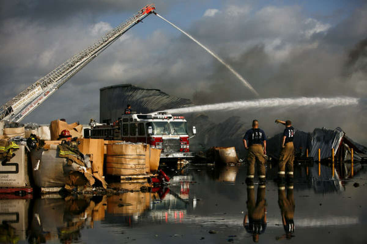 Houston firefighters were pouring water on the blaze from several directions.