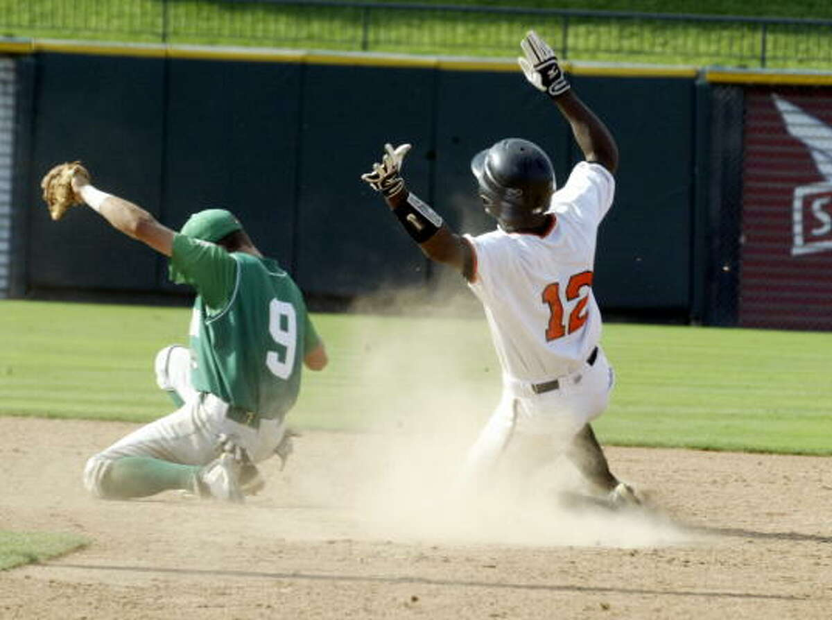 Texas High's Carlton Bailey steals second safely behind Brenham shortstop Drake Roberts.