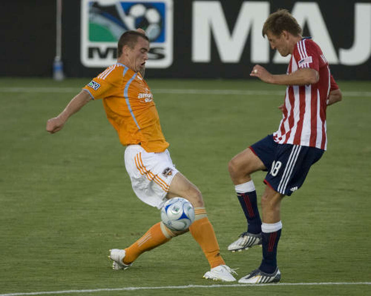 The Houston Dynamo's Cam Weaver, left, and Chivas USA's Sasha Victorine, right, during the first half.