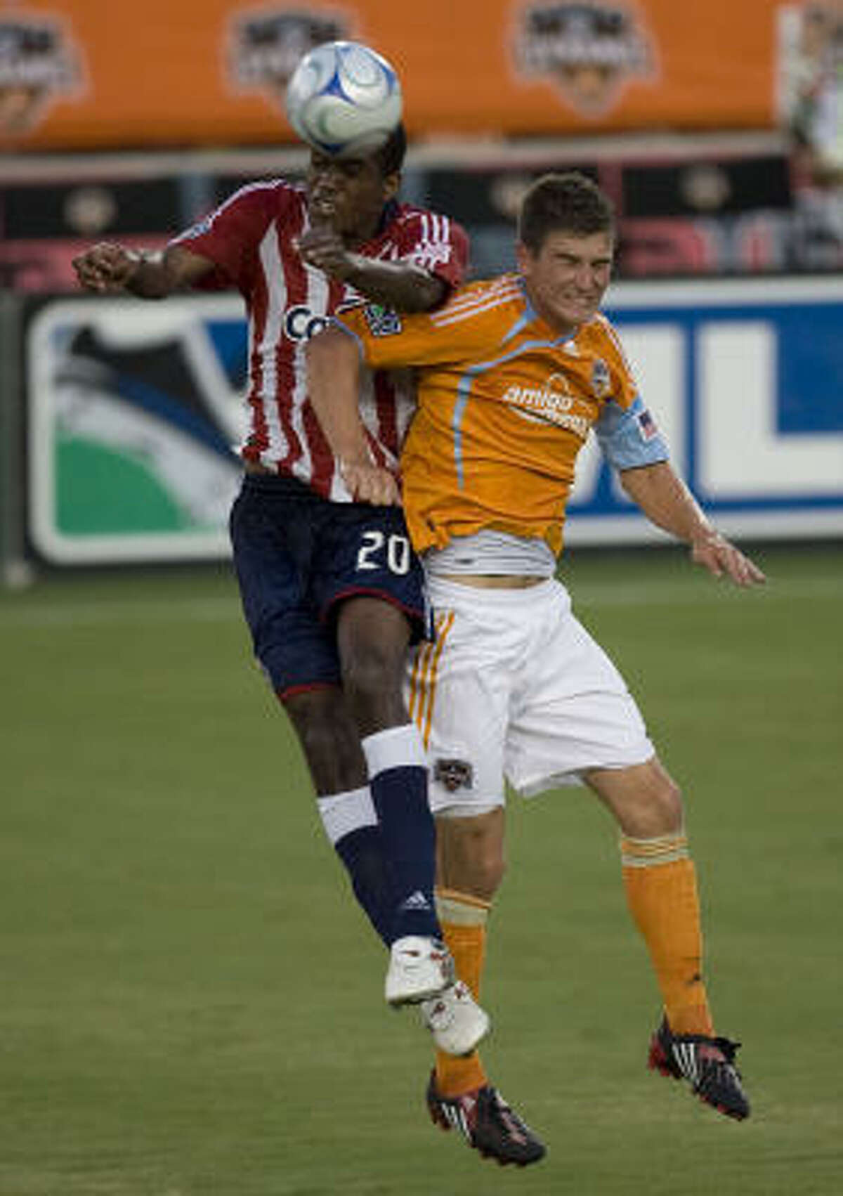 The Houston Dynamo's Bobby Boswell, right, and Chivas USA's Atiba Harris, left, during the first half.