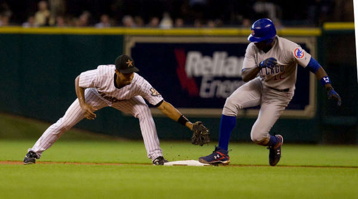 Astros second basemen Edwin Maysonet is late with a tag on a double by Cubs Alfonso Soriano in the first inning.