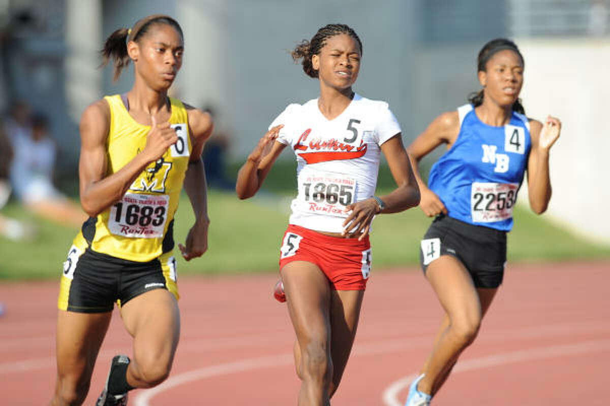 Fort Bend Marshall's Briyanni Thomas, left, and Lamar's Bria Guerin, center, compete in the 800 meter run.