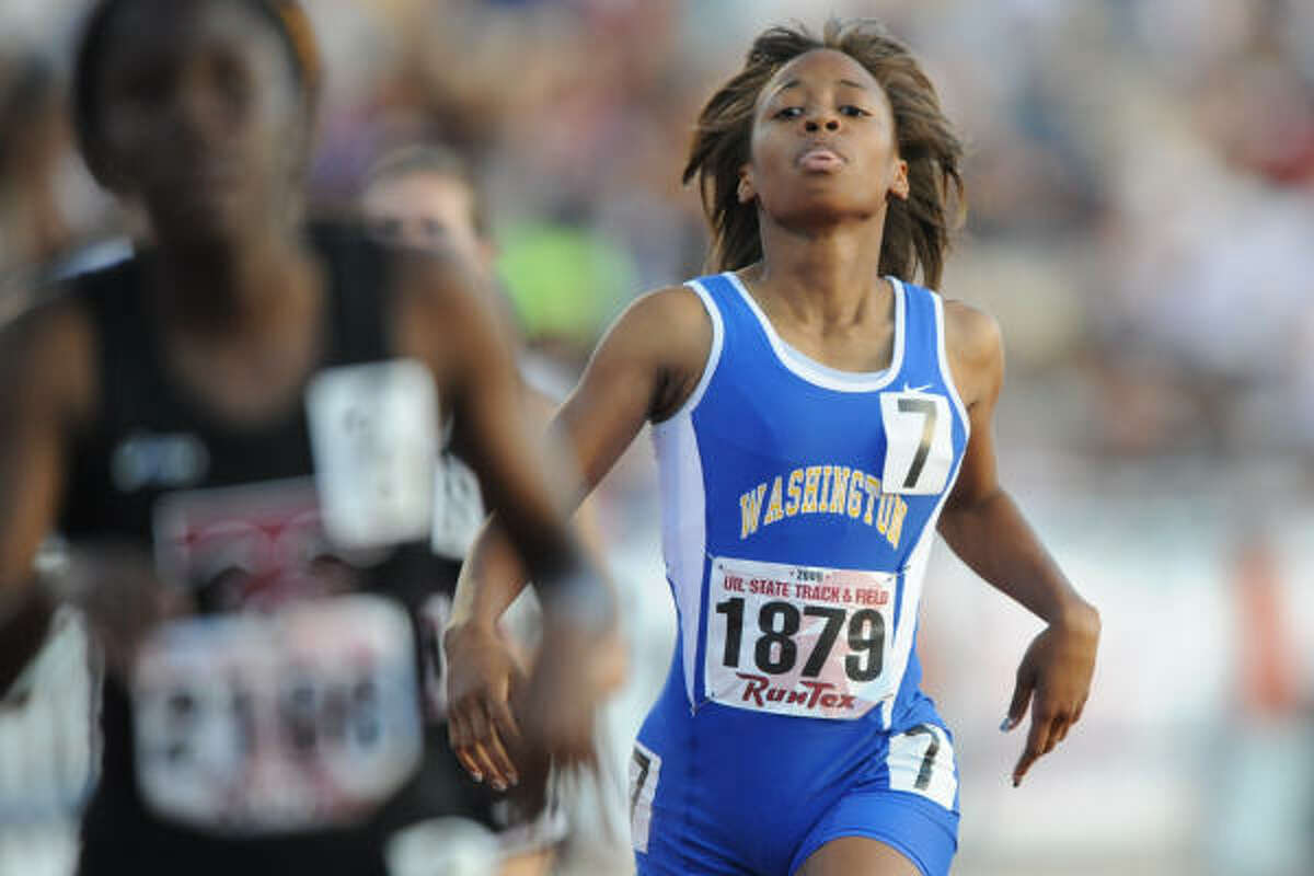 Washington's Tonicia Wimberley competes in the 400 meter dash.