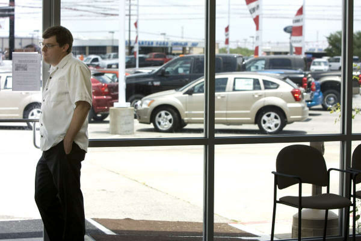 Rogers Dodge in Alvin is open for business on its last day.