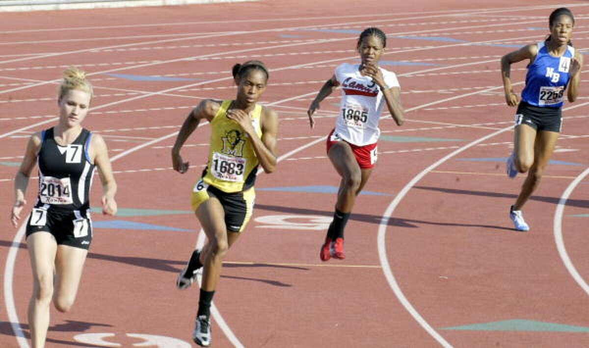 Runners come into a turn in 800-meter action.