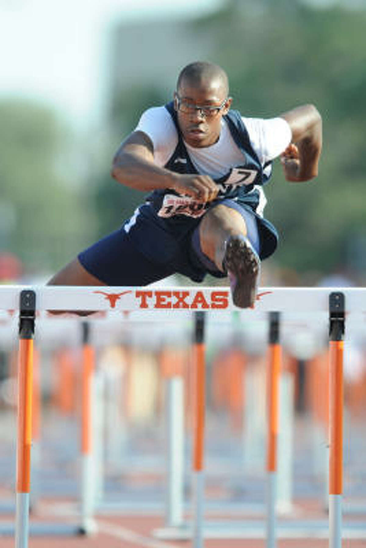State track meet: Aldine's 'Ryan Wiley clears the last of the 110-meter high hurdles at the state track championships in Austin.