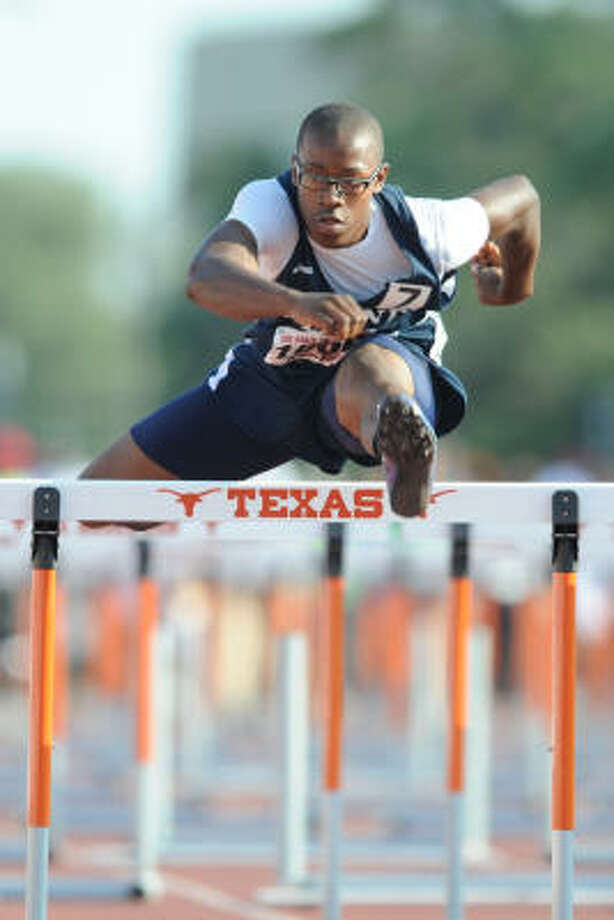 State track meet: Aldine's 'Ryan Wiley clears the last of the 110-meter high hurdles at the state track championships in Austin. Photo: Ronnie Montgomery, For The Chronicle