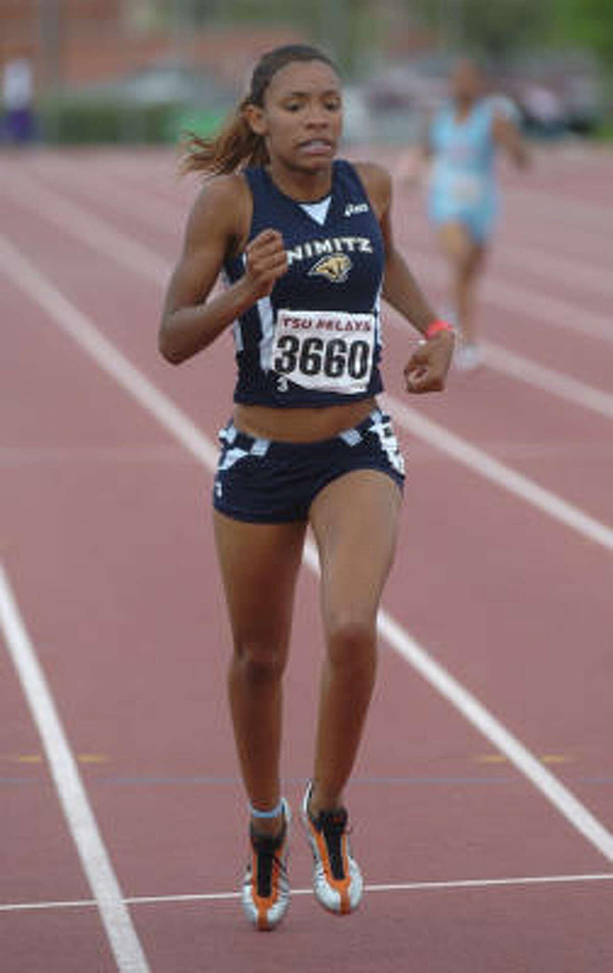 LaShunda Phipps of Nimitz competes in the 400-meter dash.