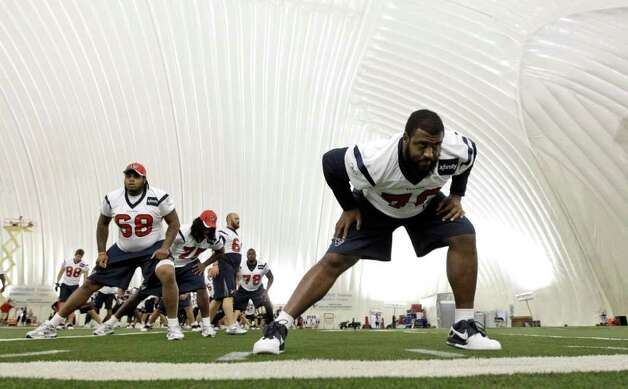 Houston Texans tackle Duane Brown, right, stretches with teammates during NFL football training camp Thursday, Aug. 4, 2011, in Houston. (AP Photo/David J. Phillip) Photo: David J. Phillip/Associated Press