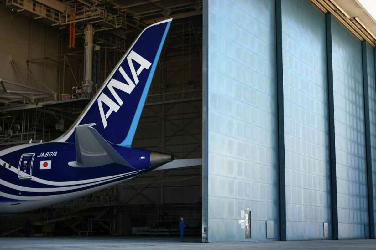 Hangar doors open to reveal of the first Boeing 787 destined for use by launch customer All Nippon Airways. The 787 livery and interior were unveiled at the Boeing plant in Everett, Wash. on Saturday, August 6, 2011. The 787 is Boeing's new composite wide-body airliner. The first plane should be delivered to ANA by the end of September.
