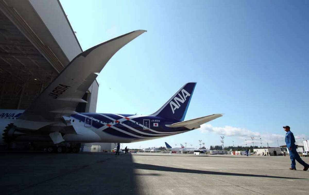 The plane is rolled out of the paint hangar during the reveal of the first Boeing 787 destined for use by launch customer All Nippon Airways. The 787 livery and interior were unveiled at the Boeing plant in Everett, Wash. on Saturday.