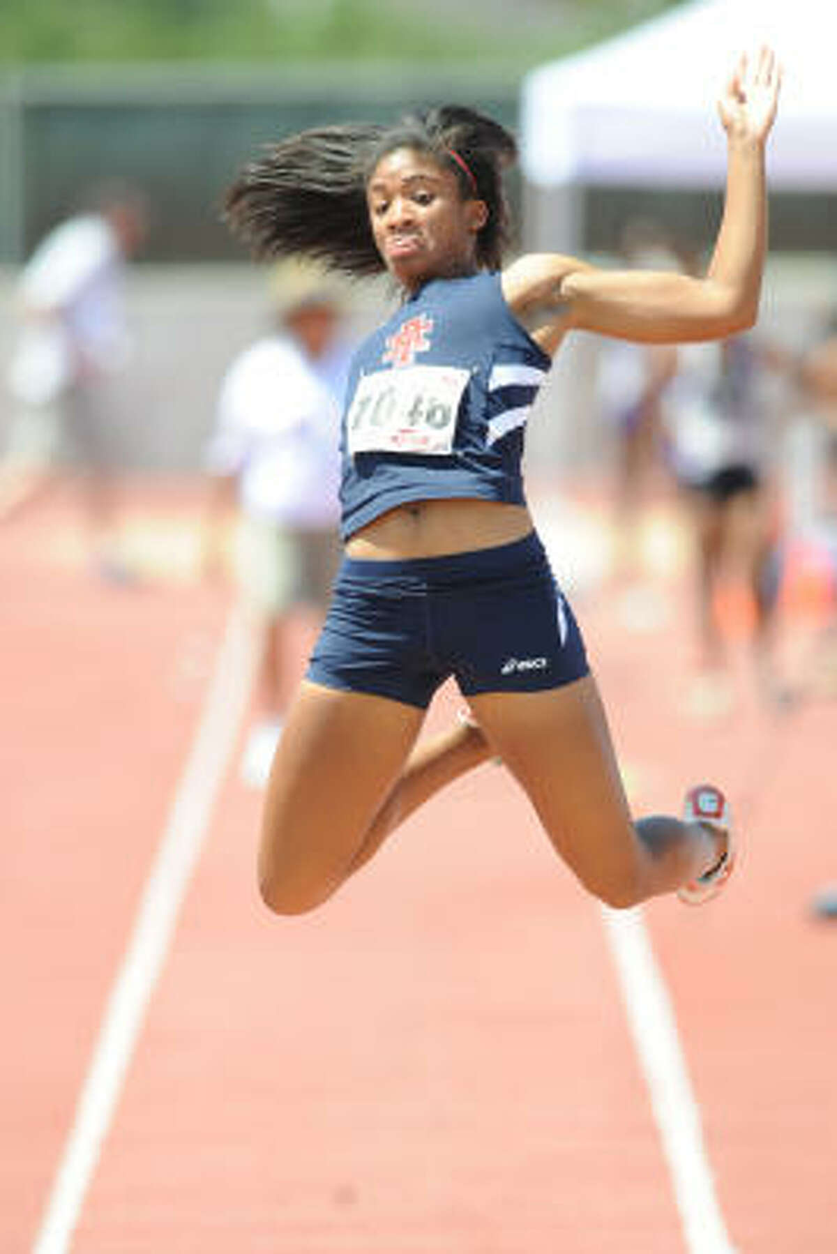 State track meet: Alief Taylor's Morgan Pressley competes in the long jump during the state track meet in Austin.