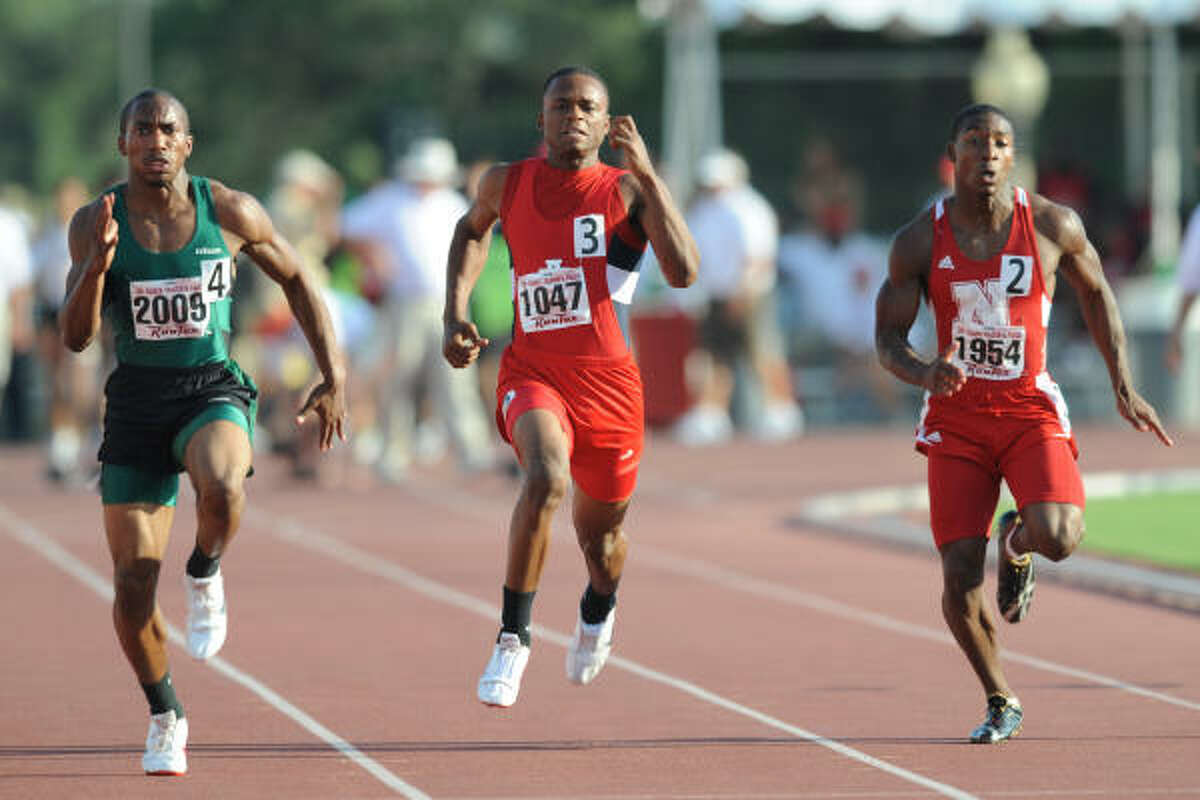 Alief Taylor's Kristen Mitchell competes in the 100-meter dash.