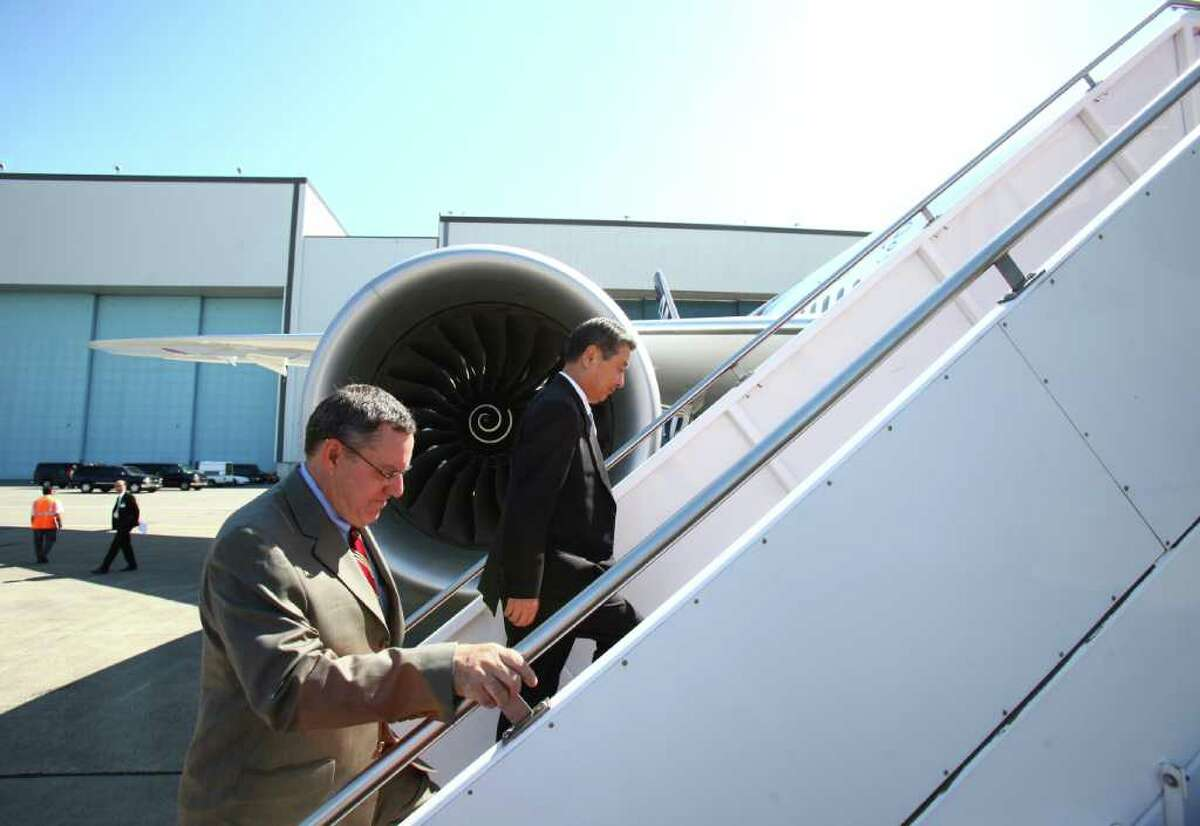 Scott Fancher, vice president and general manager of the 787 program, left, and Mitsuo Morimoto, executive vice president of All Nippon Airways, board a the first 787 Dreamliner destined for use by launch customer All Nippon Airways.