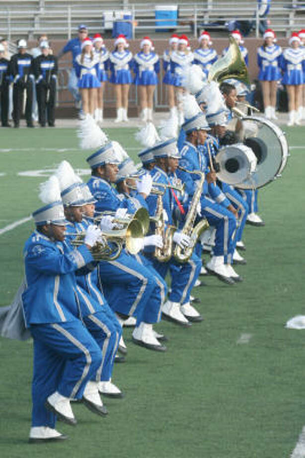 The Westbury band marches into the field at halftime. Photo: Pin Lim, For The Chronicle