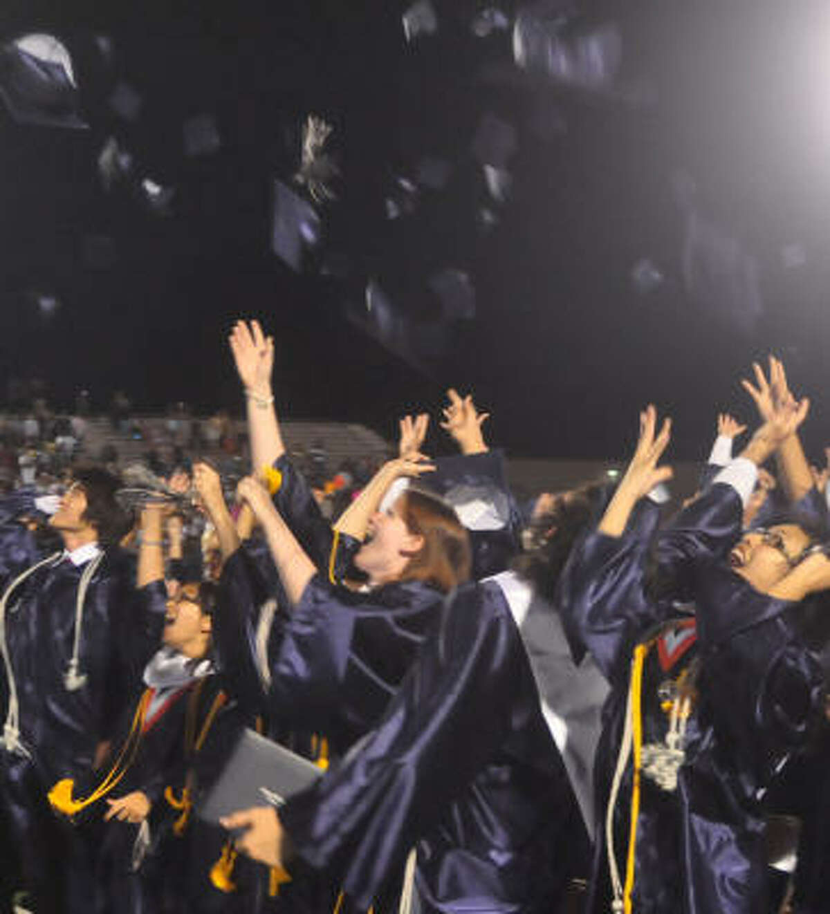 Manvel High School's first graduating class celebrates at the ceremony, which occured at Alvin High School's stadium.