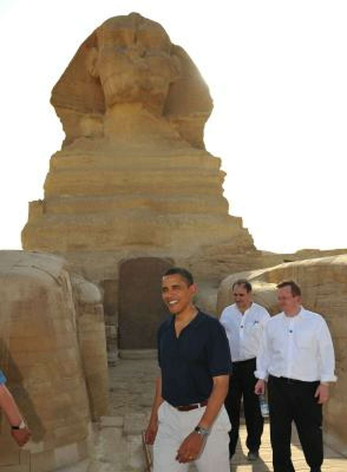 President Barack Obama walks with Press Secretary Robert Gibbs and senior advisor David Axelrod in front of the Sphinx during a tour of the Great Pyramids of Giza in Egypt on June 4.