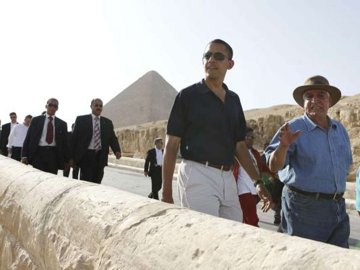 U.S. President Barack Obama tours the Sphinx and pyramids outside Cairo, Thursday, June 4. Right is Egyptian antiquities expert Zahi Hawass.