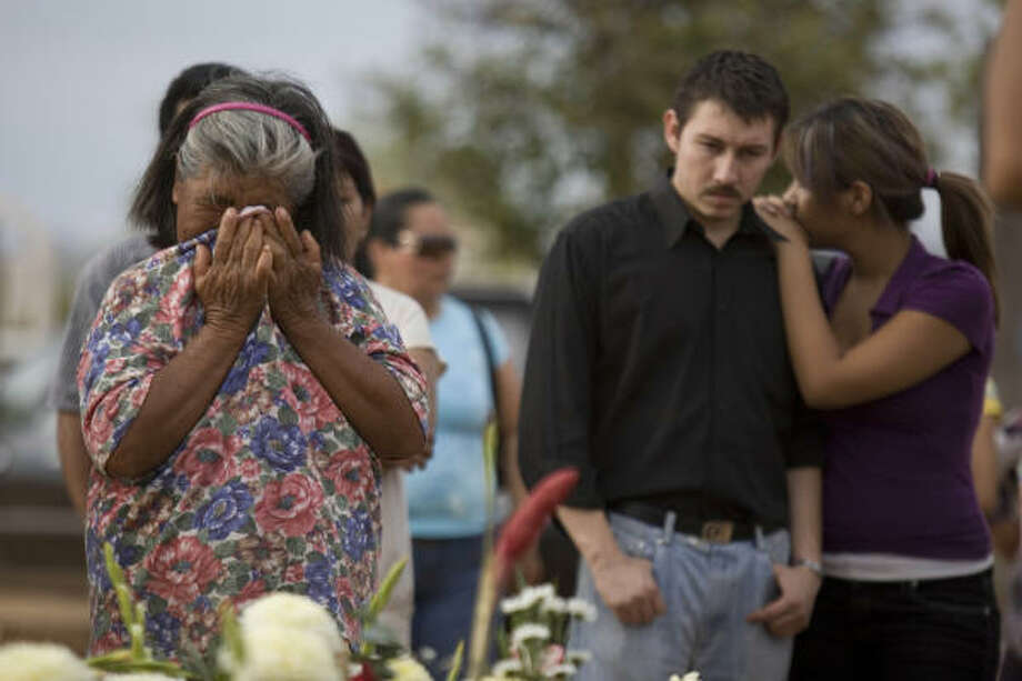 The family of 2-year-old Camila Fuentes Cervera grieves at her funeral on Saturday. The death toll rose to 40 on Sunday after two children died in hospitals, according to Sonora state health secretary Raymundo Lopez Vucovich. Photo: Alexandre Meneghini, AP
