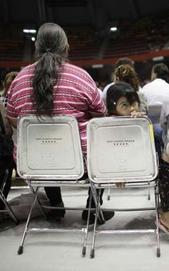 A girl waits at Sunday's Mass. Photo: Alexandre Meneghini, AP