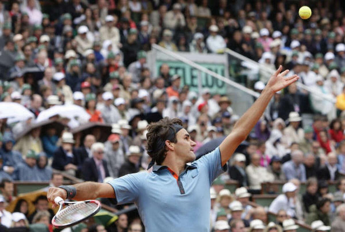 Switzerland's Roger Federer serves to Robin Soderling during their men's singles final match.