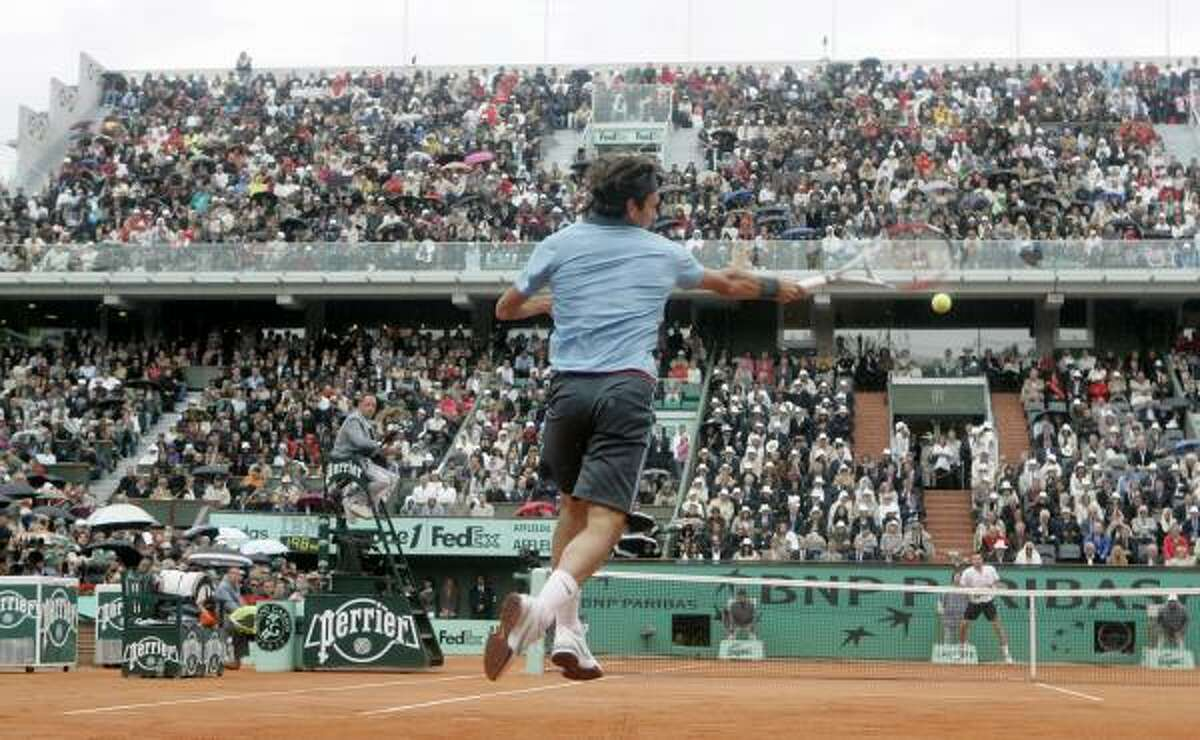 Roger Federer returns the ball to Robin Soderling during their men's singles final match at the French Open.