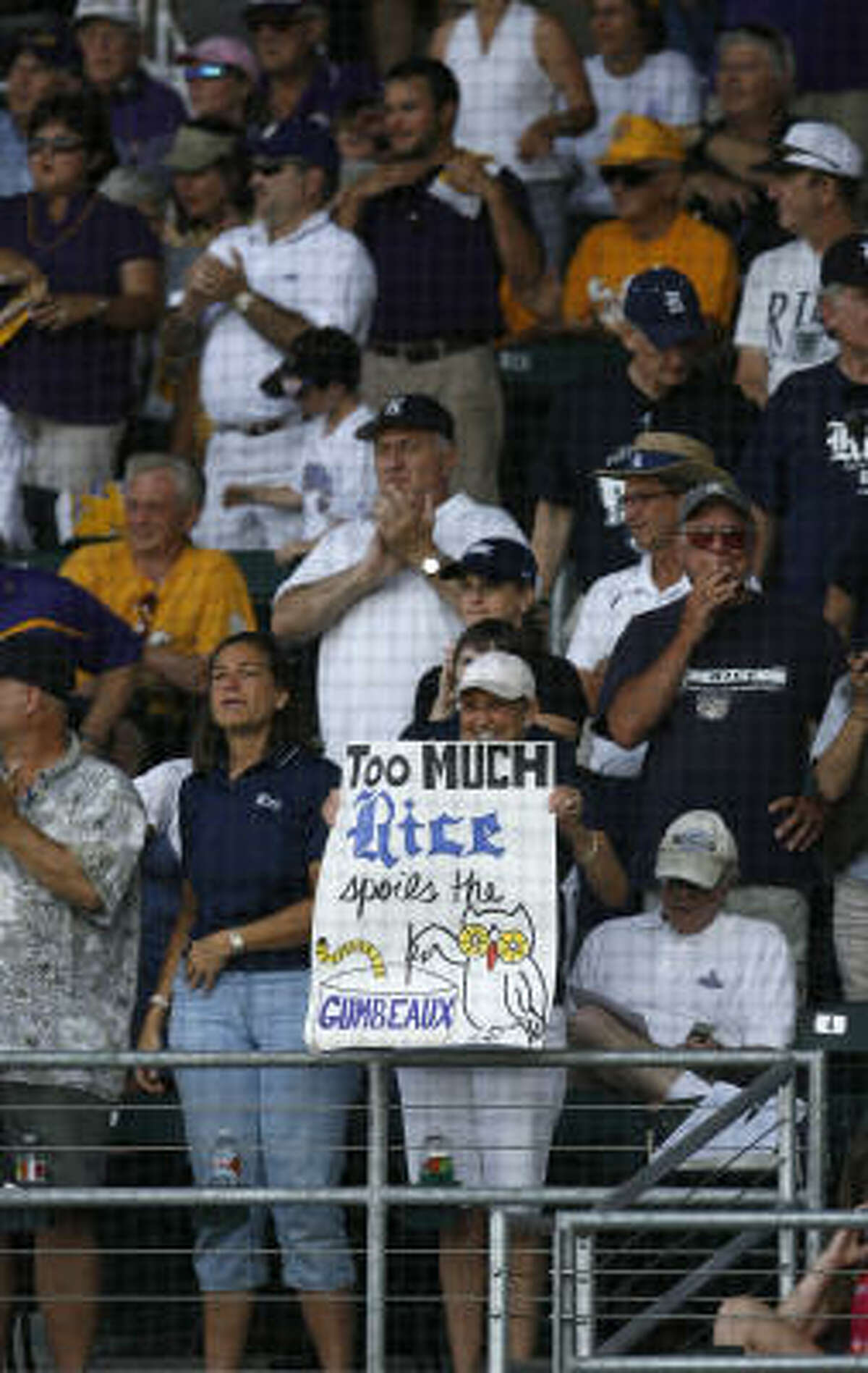 Game 1: LSU 12, Rice 9 A Rice fan holds up a sign in the stands during the first inning.