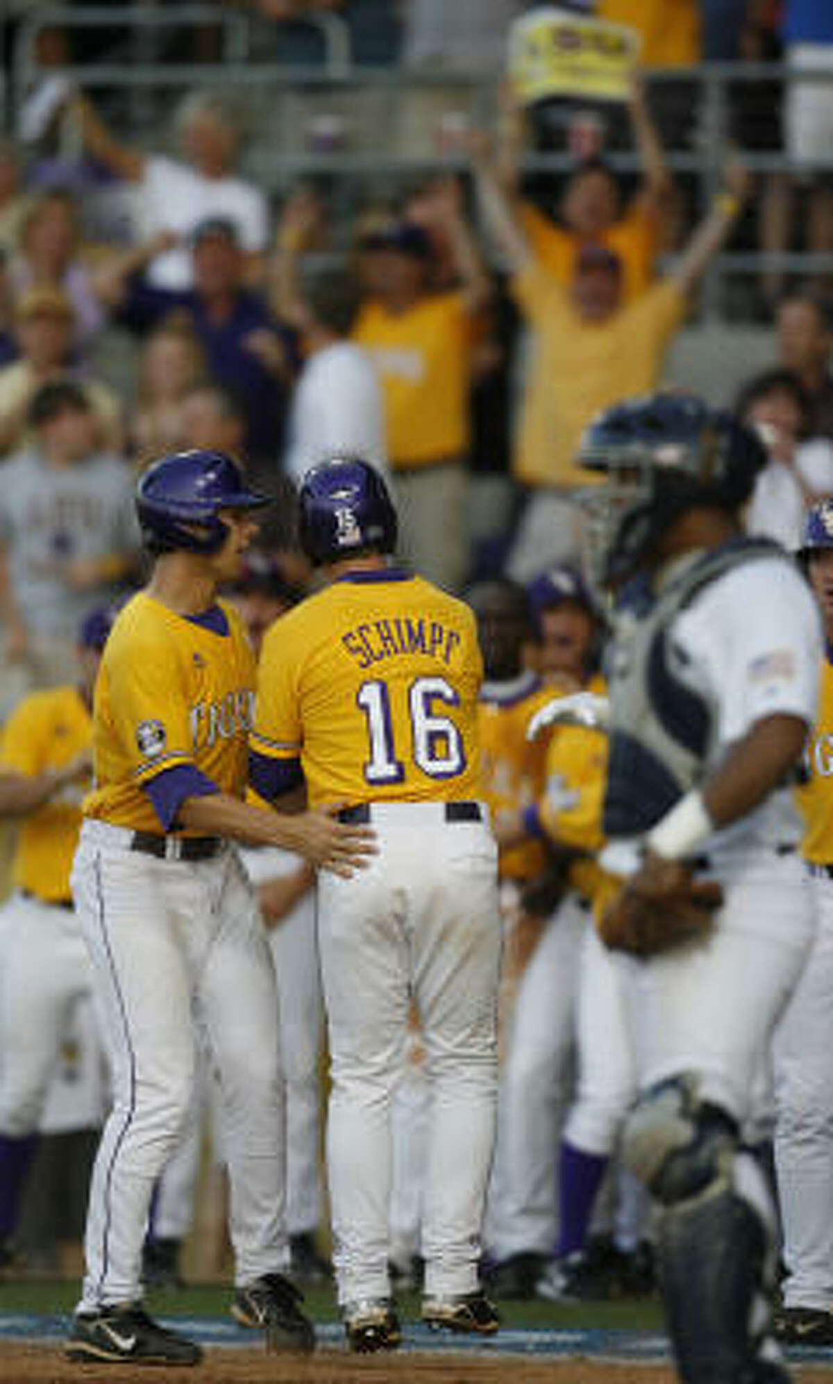 Game 1: LSU 12, Rice 9 LSU's Ryan Schimpf celebrates his three-run homer with teammates during the fifth inning.