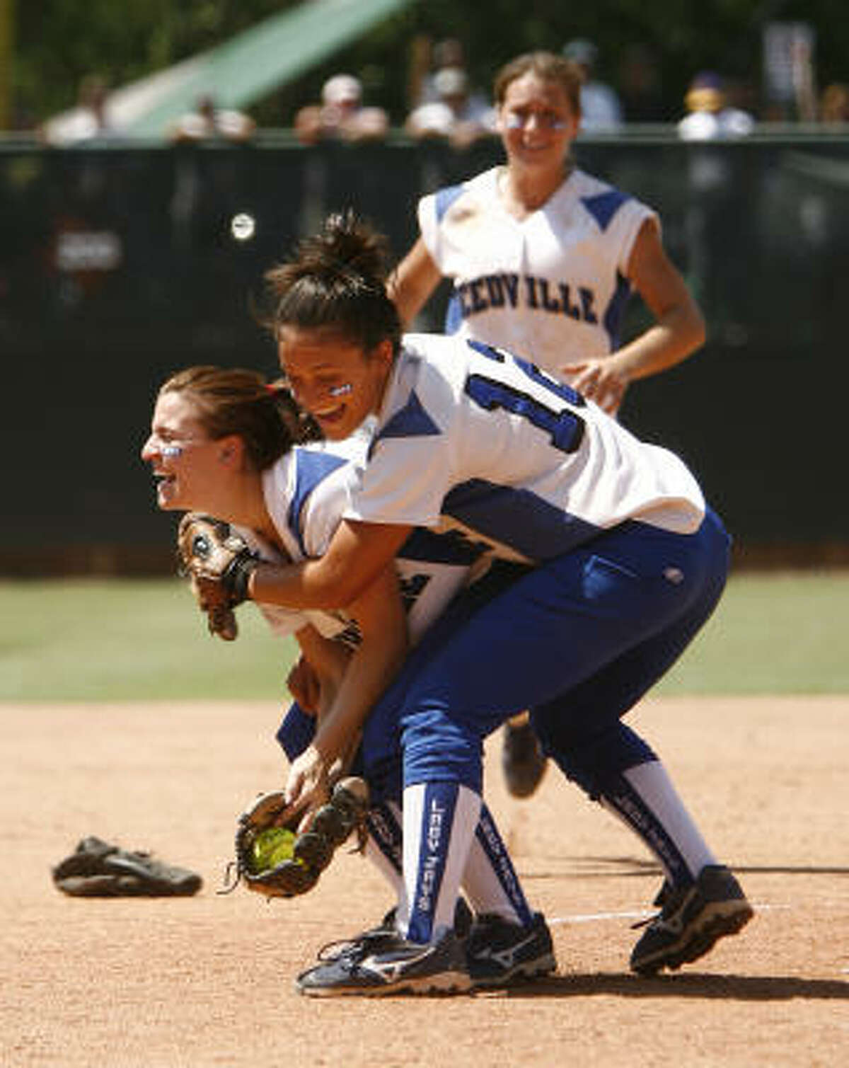 Needville pitcher and game MVP Cally Falls is hugged by second baseman Alyssa Rodriguez (12) after the last out of their 3-1 victory in the 3A state softball championship.