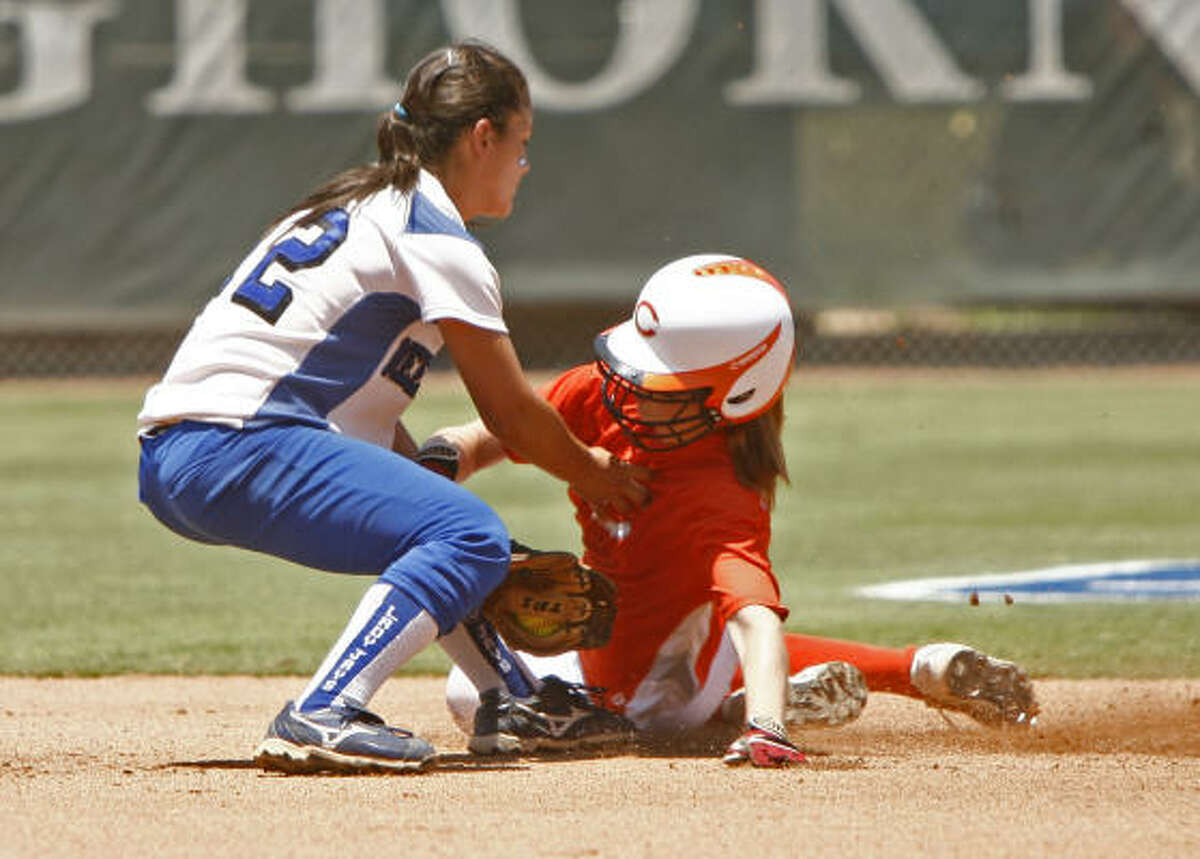 Celina's Lindsie Knowles, left, is tagged out by Needville second baseman Alyssa Rodriguez.