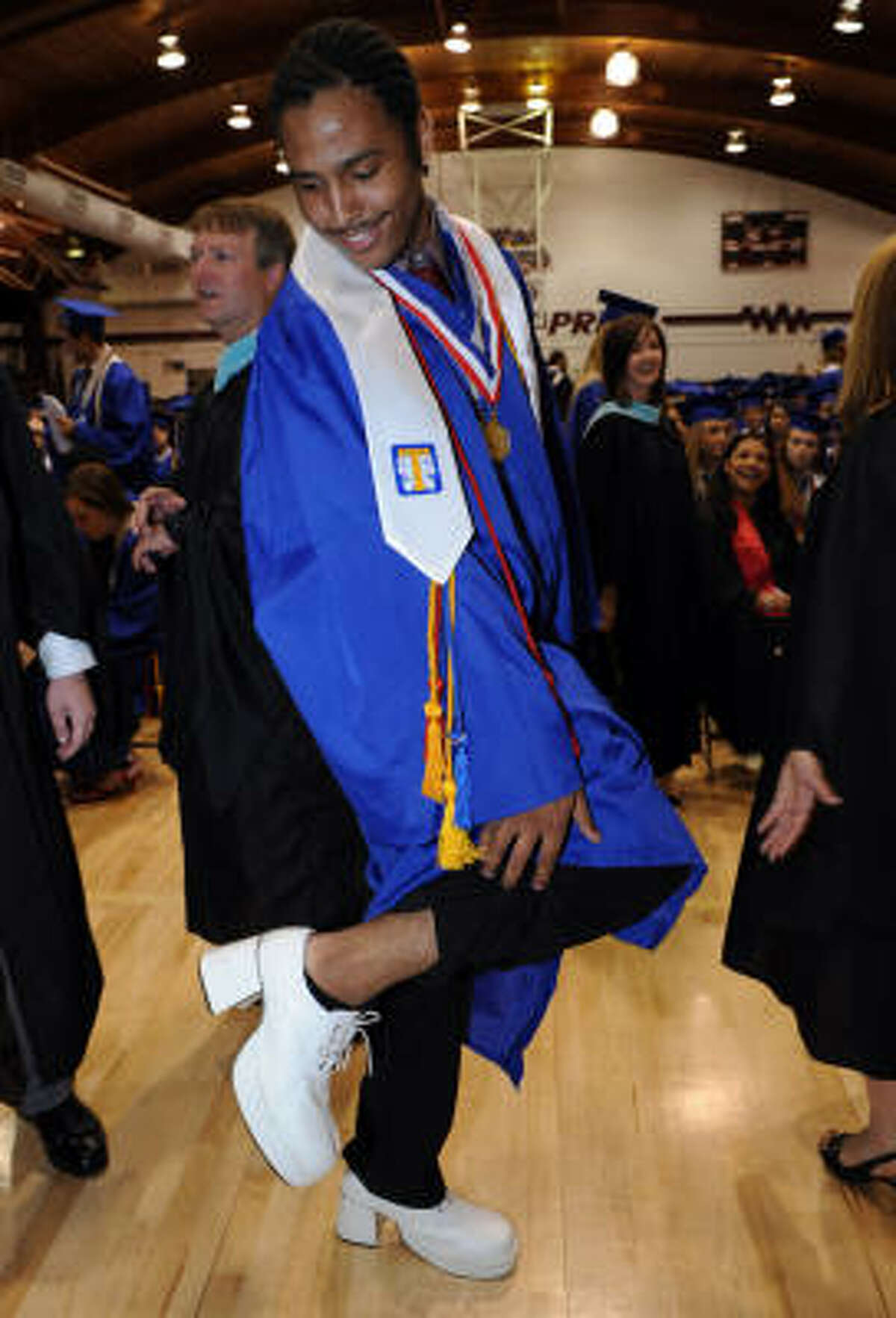 Trevor Anderson shows off his platform shoes before the ceremony.