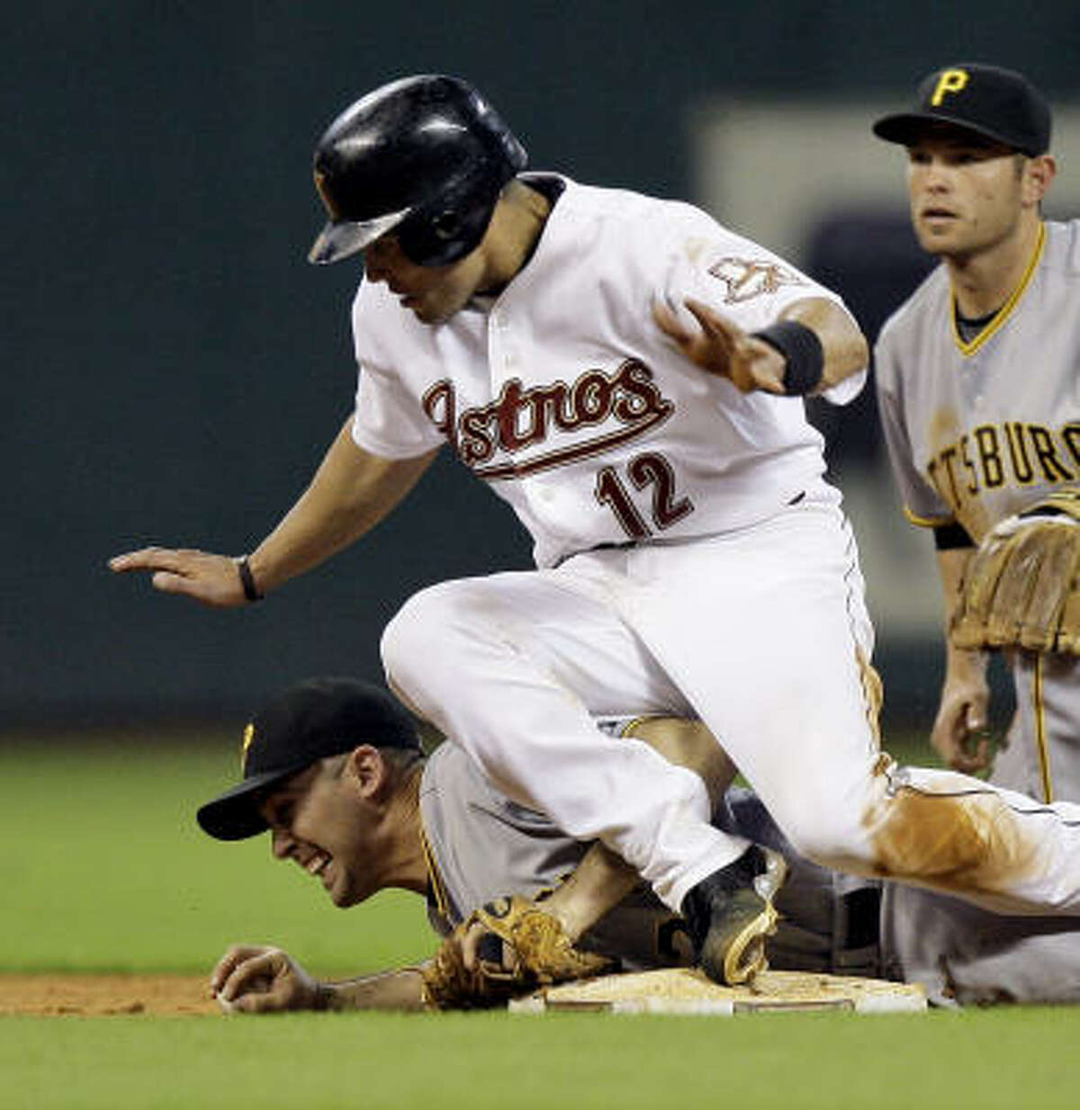 Houston's Ivan Rodriguez falls over Pirates shortstop Jack Wilson, bottom, after Wilson dove to second base to get the force out on Rodriguez in the eighth inning.