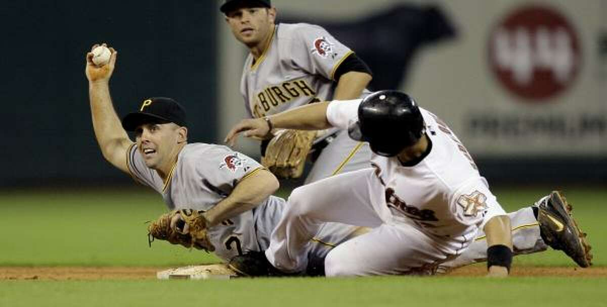 Pirates shortstop Jack Wilson (2) displays the ball as he dives onto second base for a force out on Houston's Ivan Rodriguez.