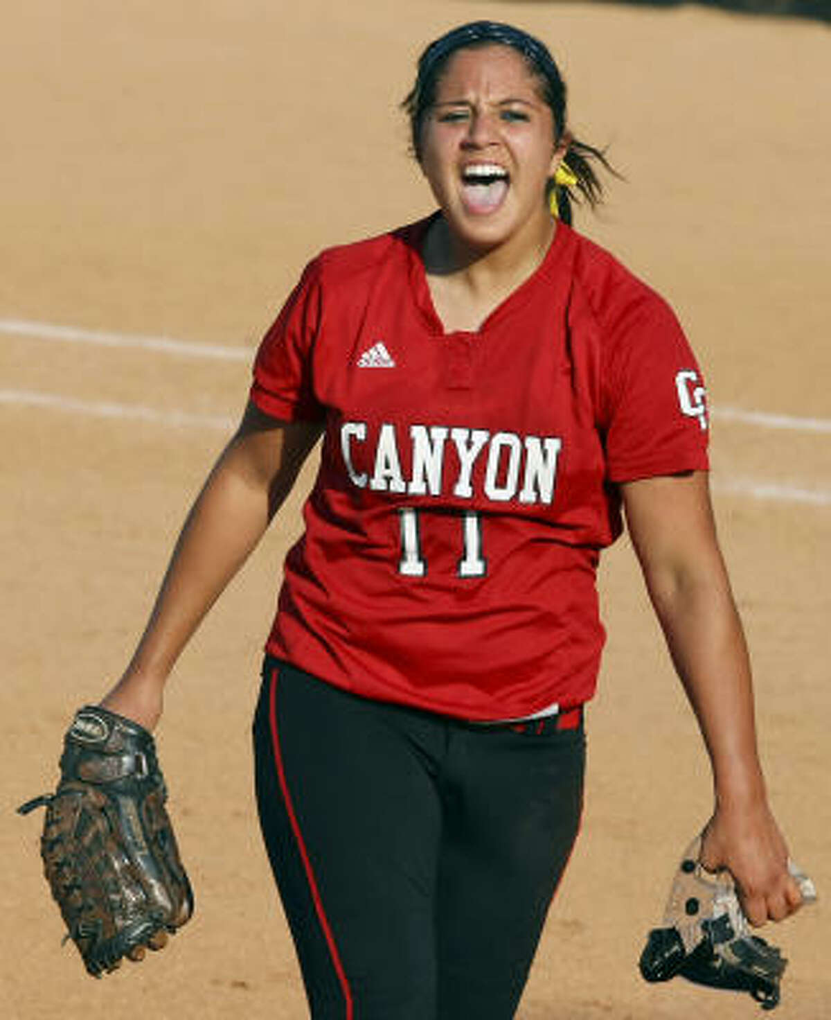 New Braunfels Canyon's Sara Mireles cheers after her team's 4-2 championship victory.