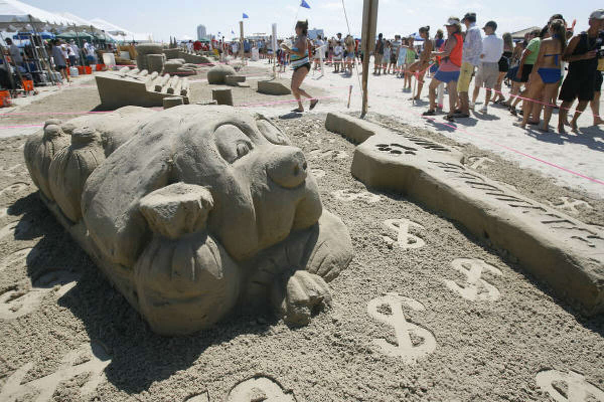 """""""Sandogg Millionaire"""" on display at the 23rd annual AIA Sandcastle Competition at Galveston's East Beach."""