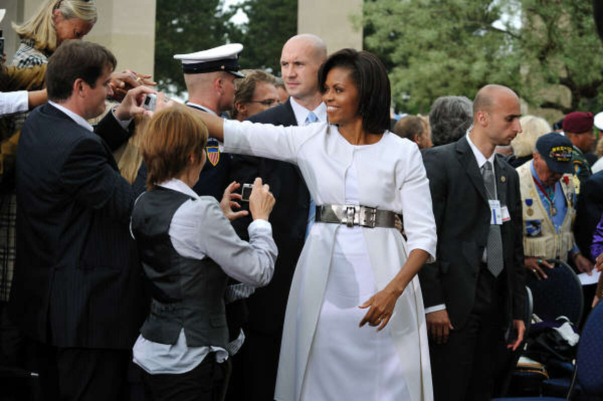 First lady Michelle Obama greets the crowd at Colleville-sur-Mer. This D-Day anniversary assumed special significance because veterans of the battle are reaching their 80s and 90s and their numbers are dwindling.