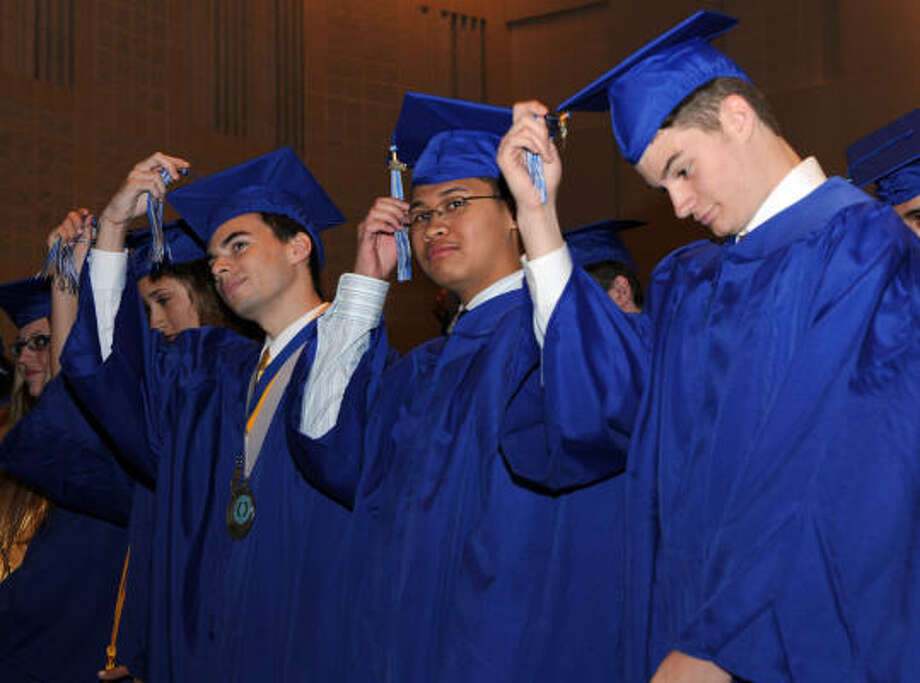 The first class of Clear Horizons Early College High School had 12 graduates who concurrently earned a high school diploma and a two-year degree from San Jacinto College. Here they move their tassels after graduating. Photo: Kim Christensen, For The Chronicle