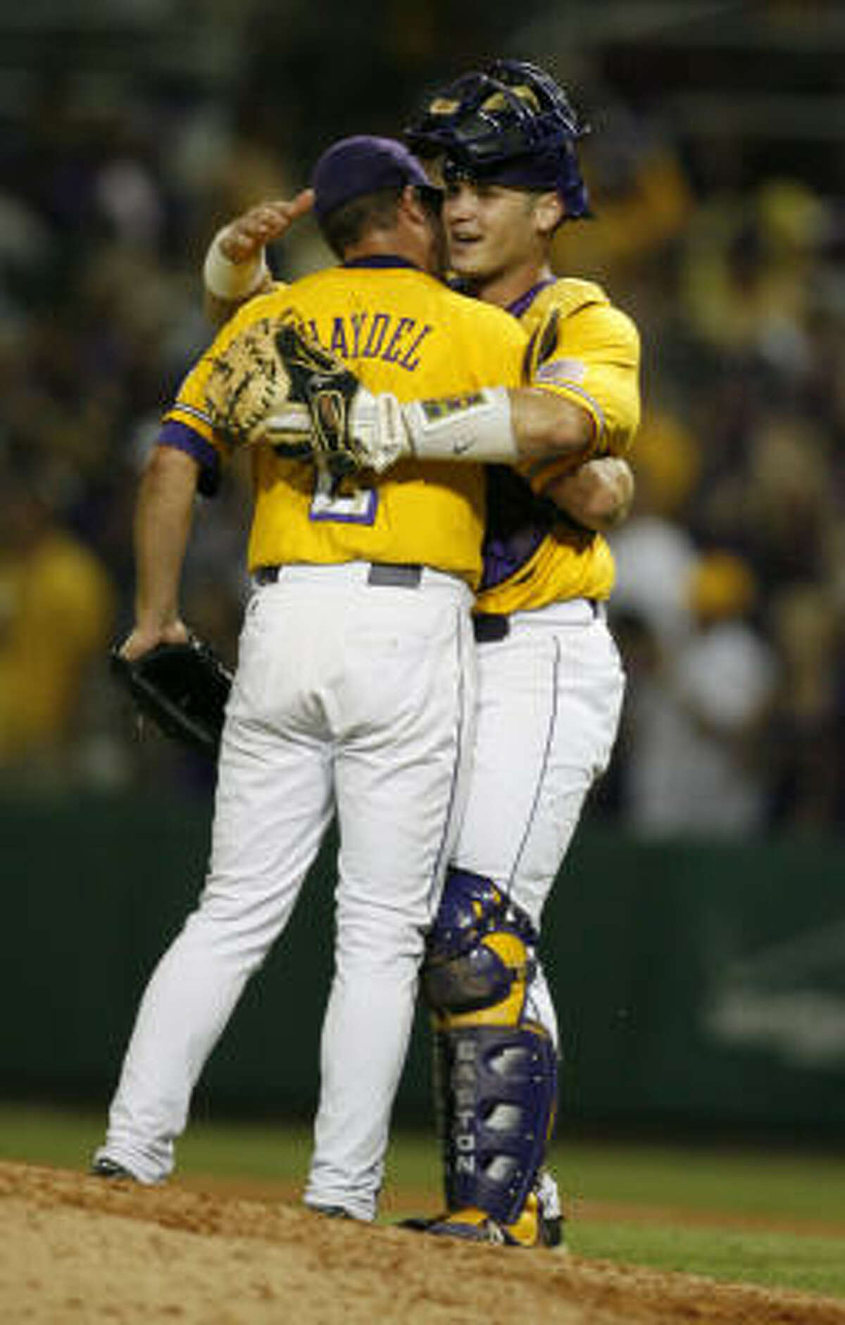 Baton Rouge (La.) Super Regional Game 1: LSU 12, Rice 9 LSU's Buzzy Haydel celebrates with catcher Micah Gibbs after winning Game 1.