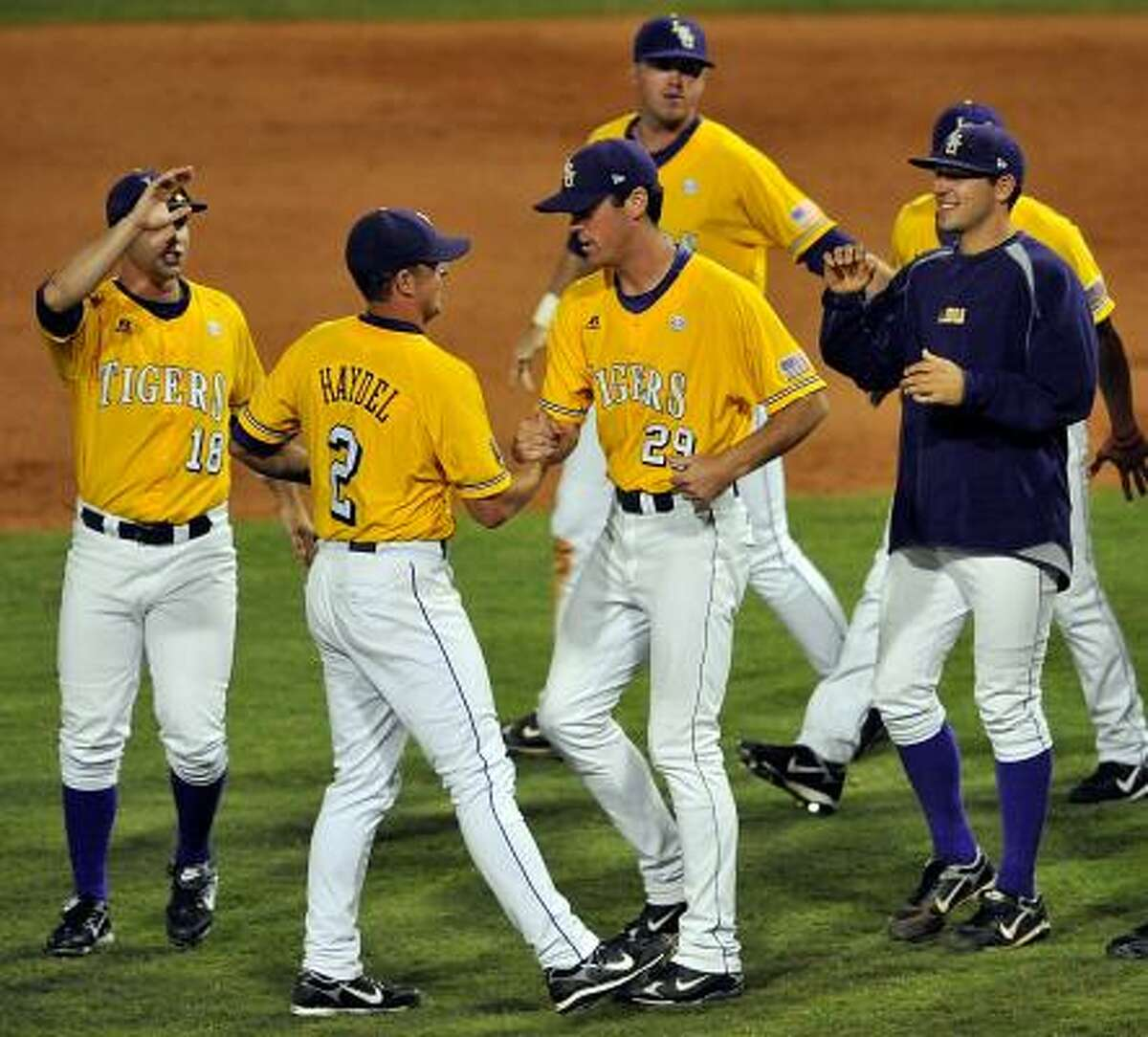 Baton Rouge (La.) Super Regional Game 1: LSU 12, Rice 9 LSU's Buzzy Haydel is congratulated by pitcher Louis Coleman after the Tigers won the opener of the best-of-three super regional.