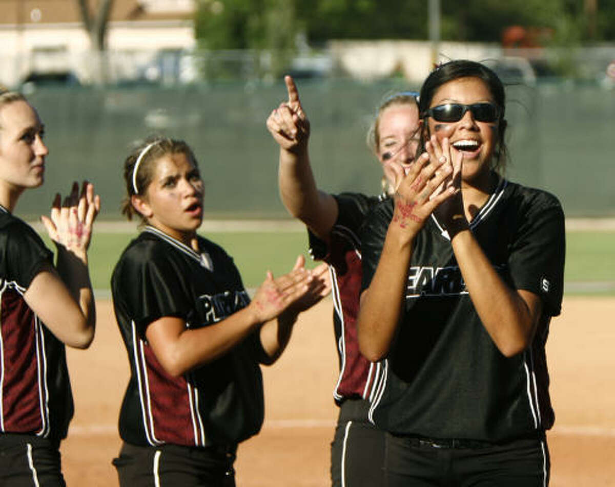 Pearland pitcher Jessica Bowden, right, celebrates with teammates after defeating Vista Ridge 3-0 to advance to the Class 5A state softball championship game.