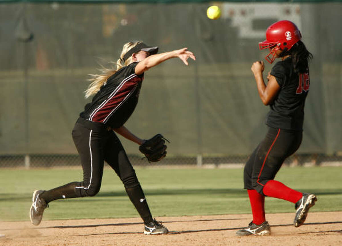 Pearland shortstop Jaclyn Bechtle completes a double play by throwing over Vista Ridge's Erika Vital.