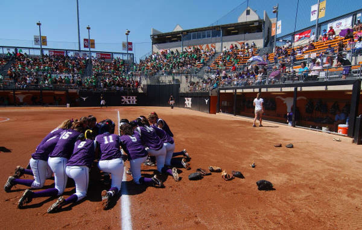 The Angleton Wildcat softball team huddles before the start of their 4A Semi-Final match up against Azle on Friday in Austin.