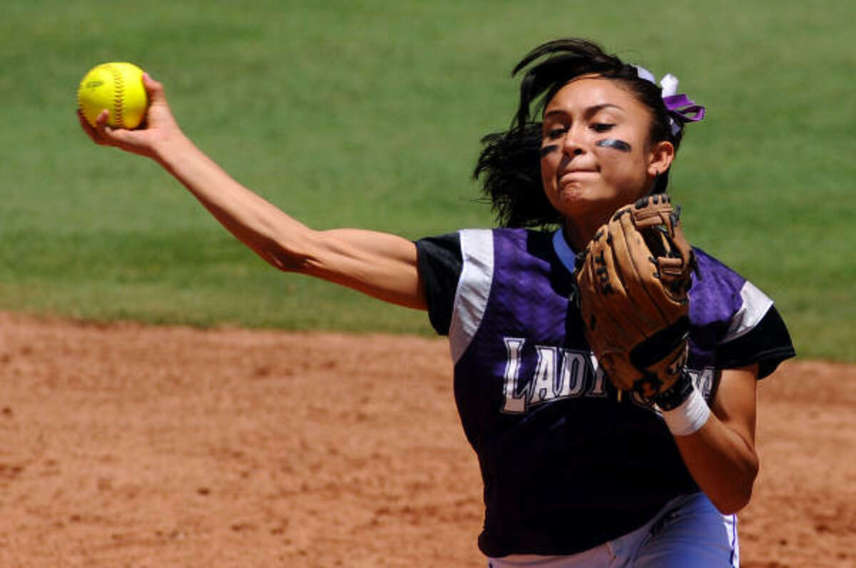Angleton's Gabby Banda throws to second base for an out.