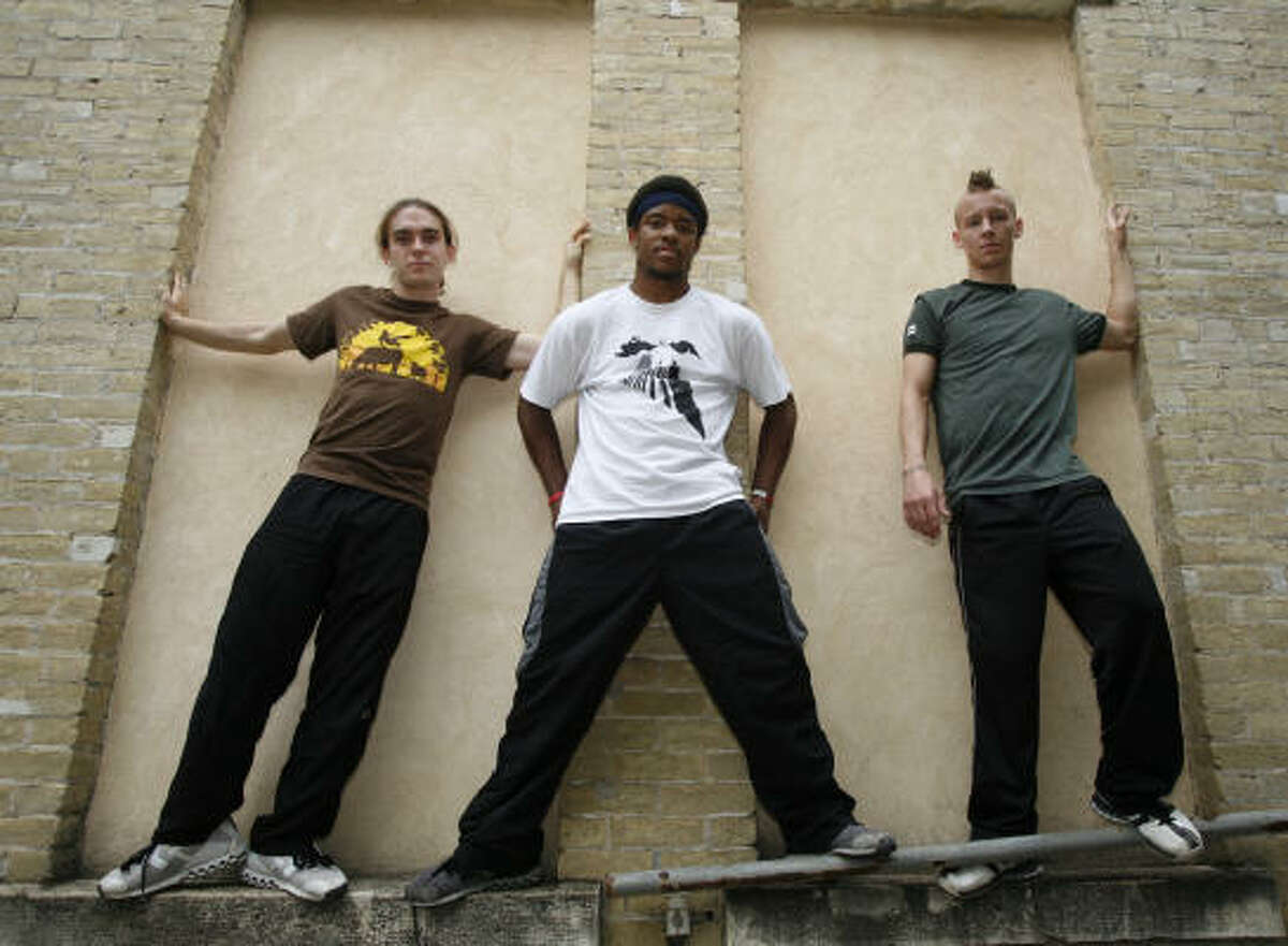Parkour athletes, from left, Jereme Sanders, 20, Devin Martin, 18 and Mike Avery, 19, are working to convince city officials in Converse to allow them to develop a parkour park on roughly an acre of city park land.