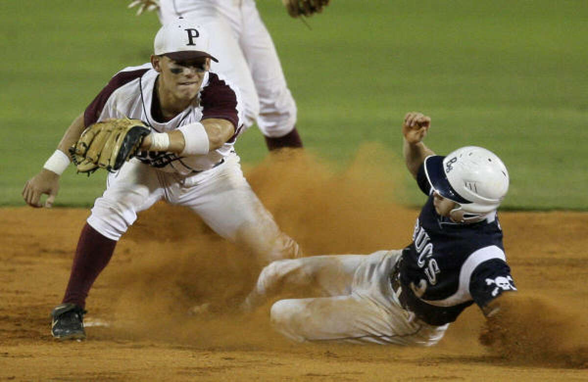 Brazoswood's Eric Watts slides safely into second base before Pearland's Josh Gonzales can make the tag during third inning
